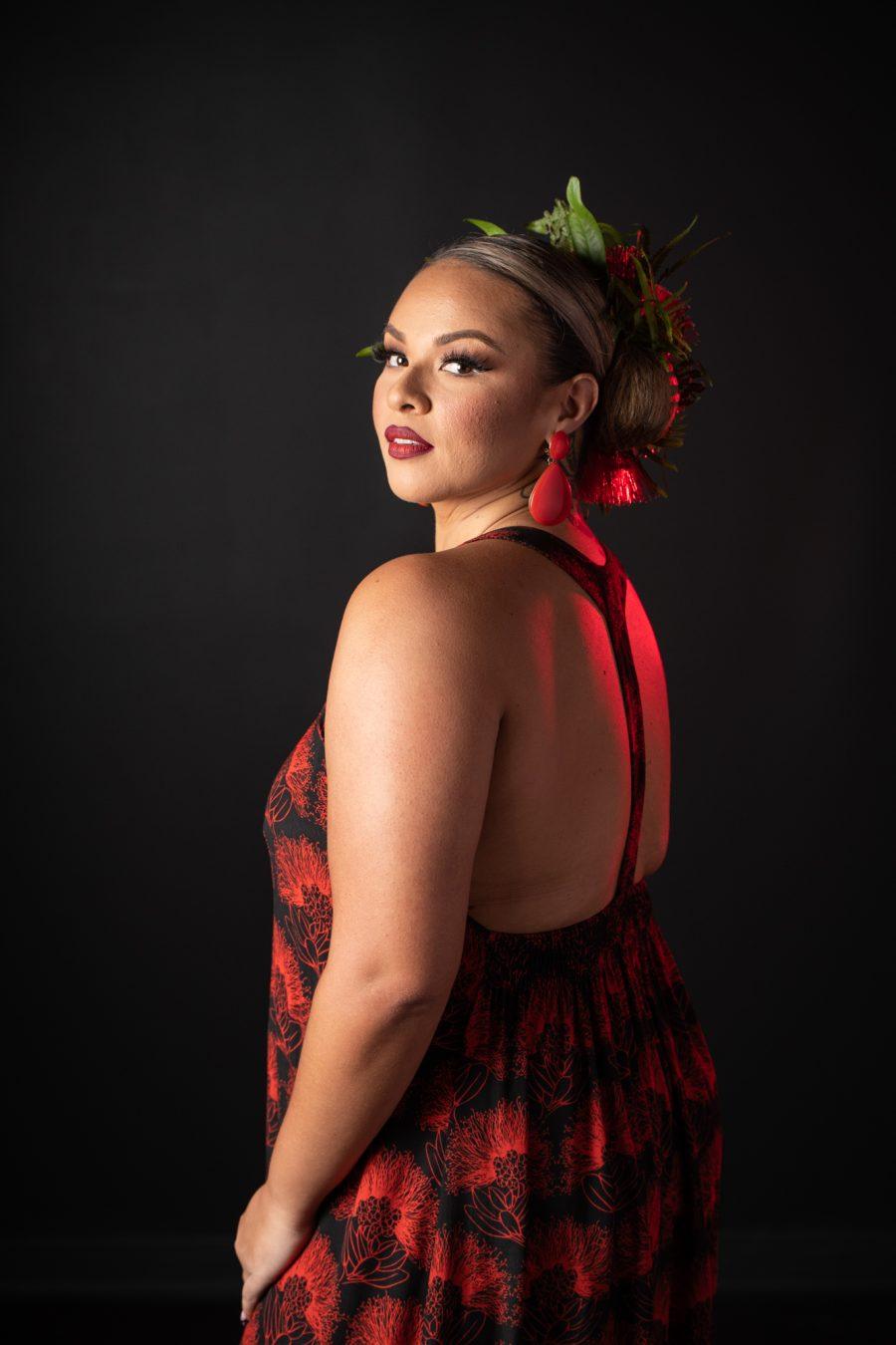 Model wearing Ihilani Dress in Black Firey Red Kalihilehua Pattern - Back View