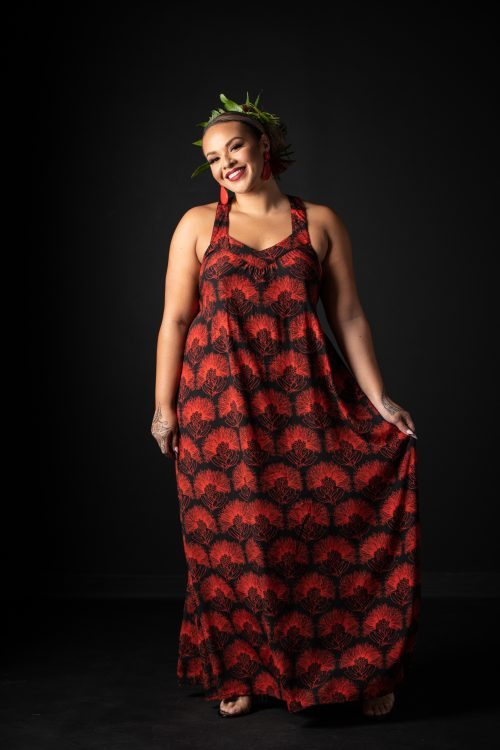 Model wearing Ihilani Dress in Black Firey Red Kalihilehua Pattern - Front View
