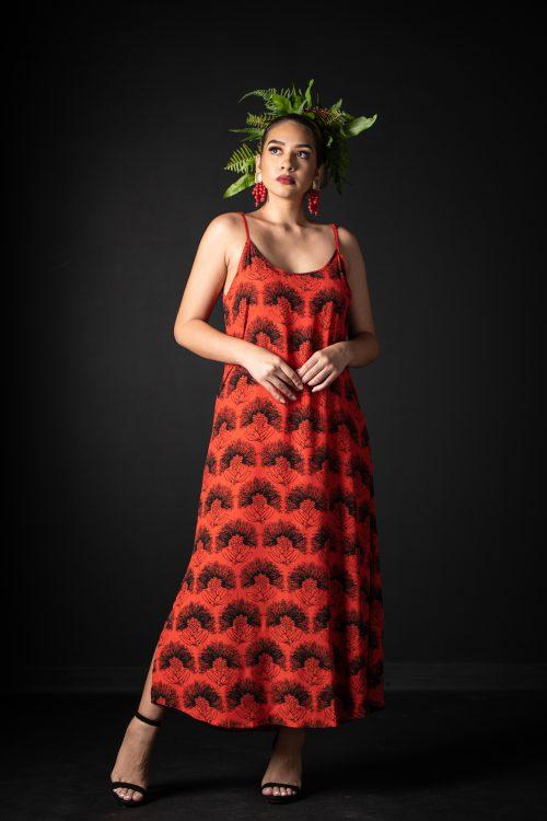 Model wearing Uluniu Maxi Dress in Firey Red-Black Kalihilehua Pattern - Front View