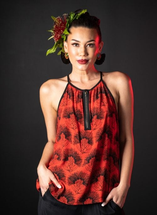 Model wearing Kaiulani Top in Firey Red Black Kalihilehua Pattern - Front View
