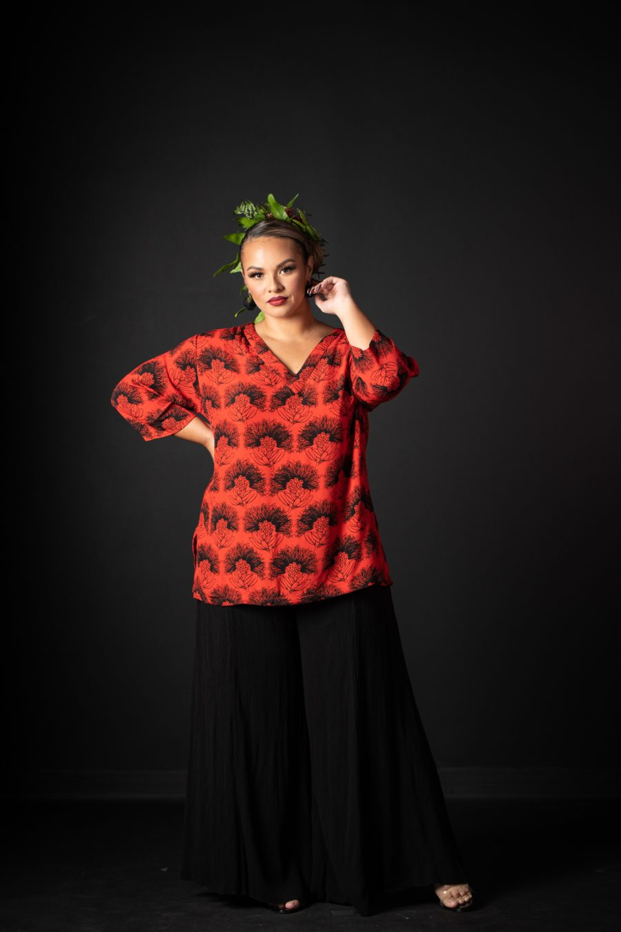 Model wearing Kahaku Top in Firey Red Black Kalihilehua Pattern