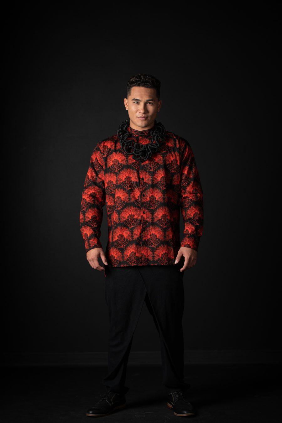Male model wearing Pake Shirt in Black Firey Red Kalihilehua Pattern - Front View