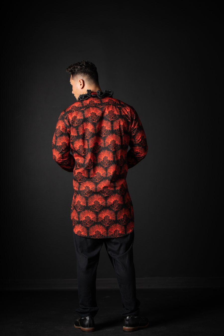 Male model wearing Pake Shirt in Black Firey Red Kalihilehua Pattern - Back View