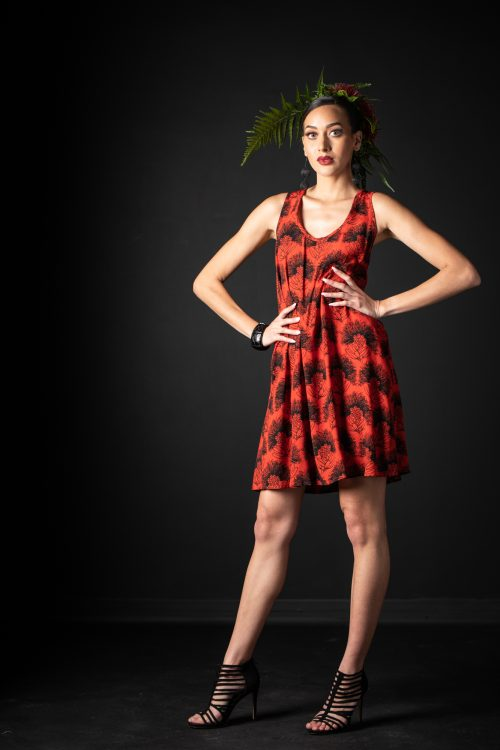 Model wearing Kaimanahila Short Dress in Firey Black-Red Kalihilehua Pattern - Front View
