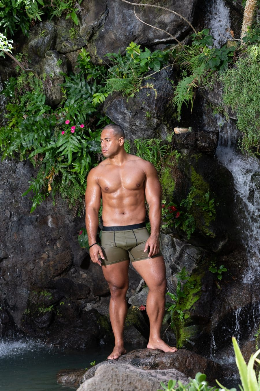 Male model wearing Manaola Trunks in Martini Olive Solid - Front View