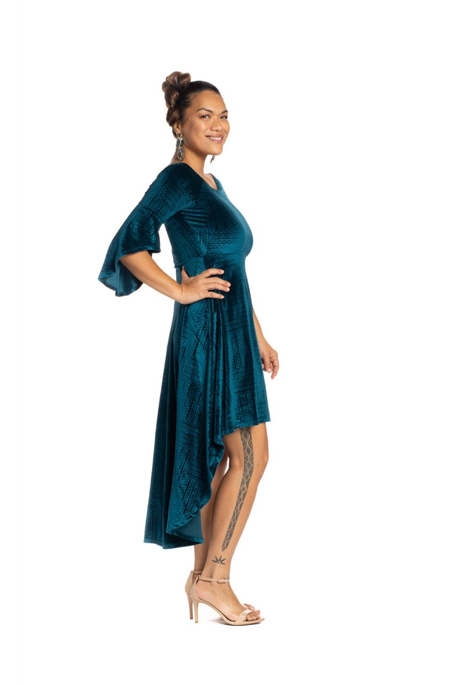Model wearing Melia Dress in Peacock Teal Ulana Pattern- Side View