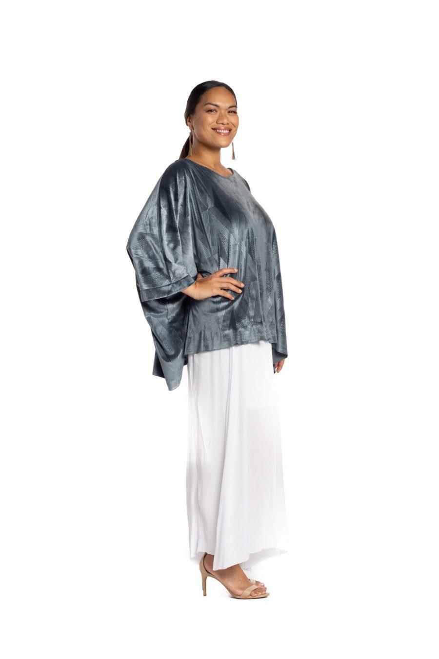 Model wearing Pakele Top in Sharkskin Kanaloa Pattern- Side View