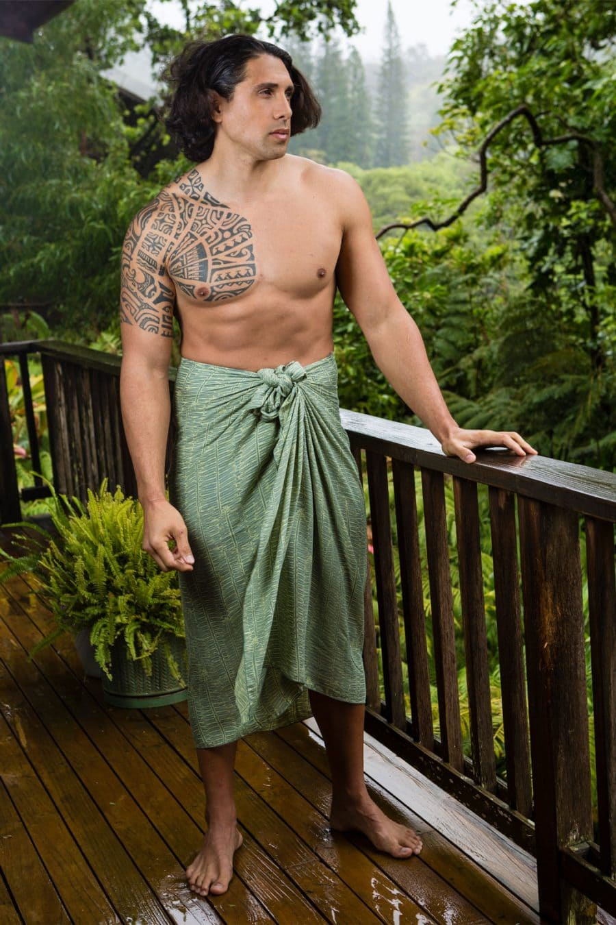 Male model wearing Lily Pad Margarita Pareo wrap in Kupukupu pattern