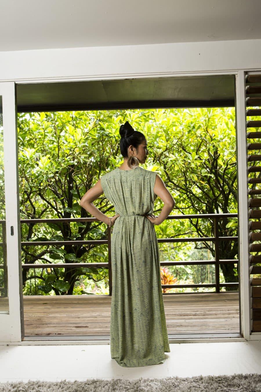Model wearing Alena Long Dress in Margarita Lily Pad Kupukupu Pattern back view