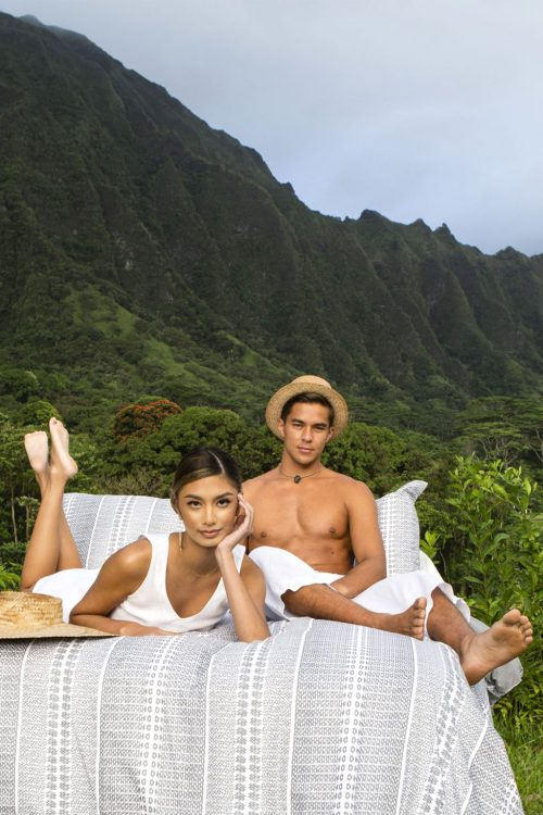 Male and Female Model laying on Manaola Duvet King Set in Stone Akoakoa Pattern