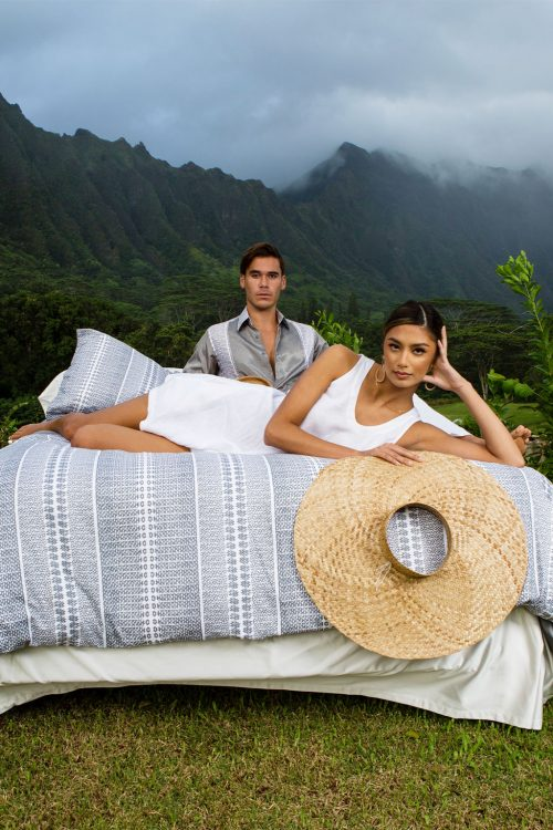 Male and Female Model laying on Manaola Duvet Queen Set in Stone Akoakoa Pattern