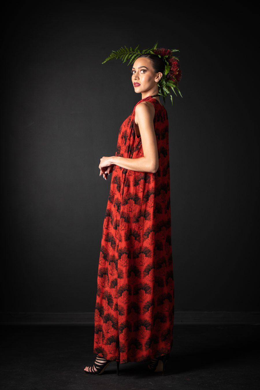 Model wearing Malia Long Dress in Firey Red-Black Kalihilehua Pattern- Side View
