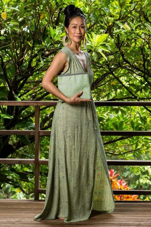 Model holding Flat Zip Pouch in Margarita Lily Pad Kupukupu pattern