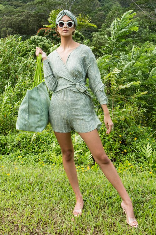 Model wearing Kauna'oa Romper in Lily Pad Margarita Kupukupu pattern