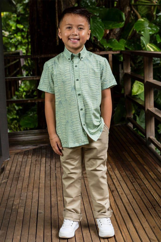 Boy wearing Keiki shirt in Lily Pad Margarita Kupukupu pattern front view