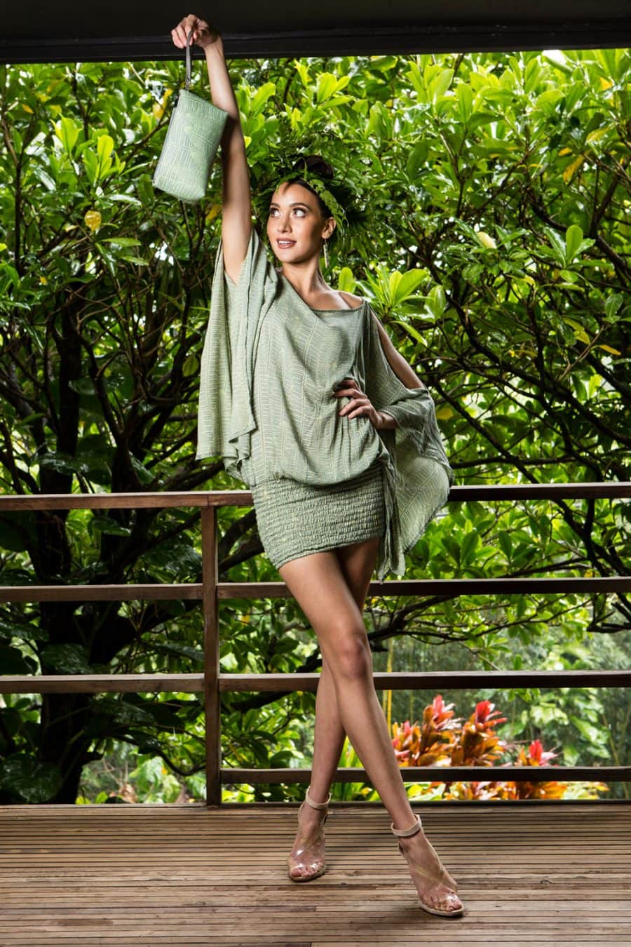 Model holding Long Zip Pouch in Margarita Lily Pad Kupukupu pattern