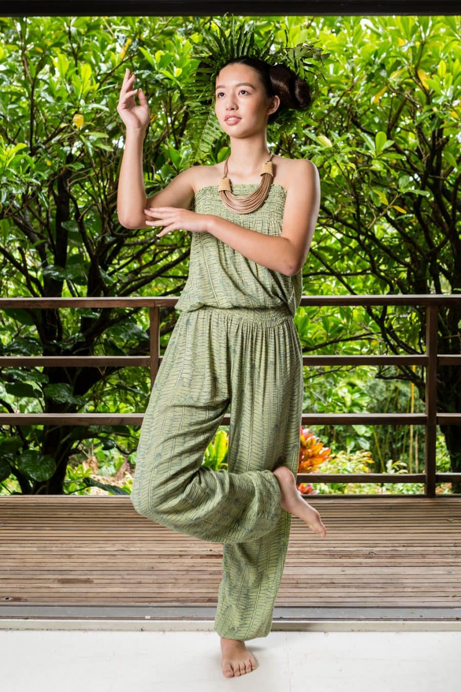 Model wearing Nanea Jumpsuit in Margarita Lily Pad Kupukupu front view
