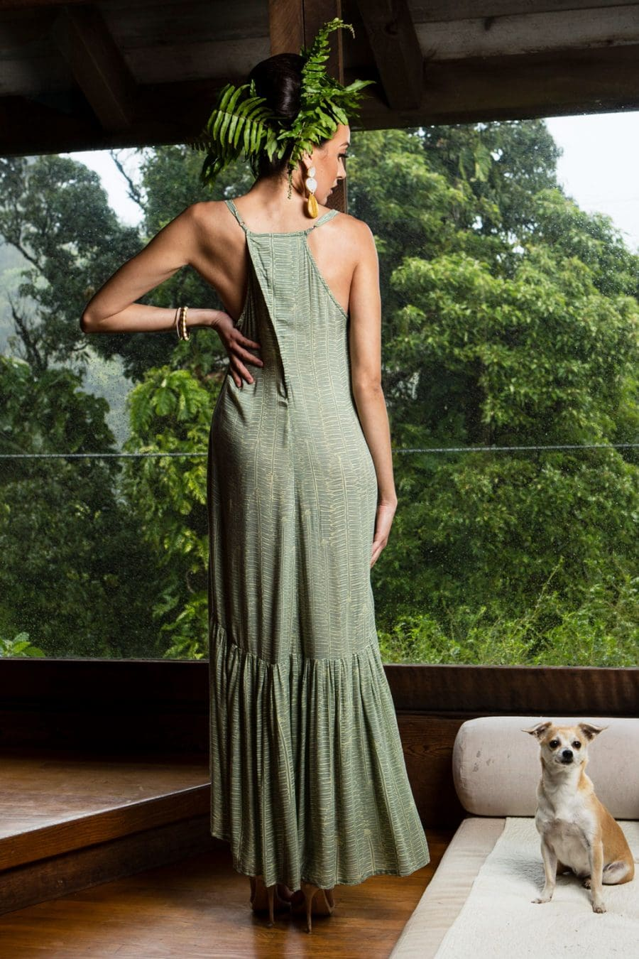 Model wearing Oluolu Maxi Dress in Lily Pad Margarita Kupukupu pattern back view