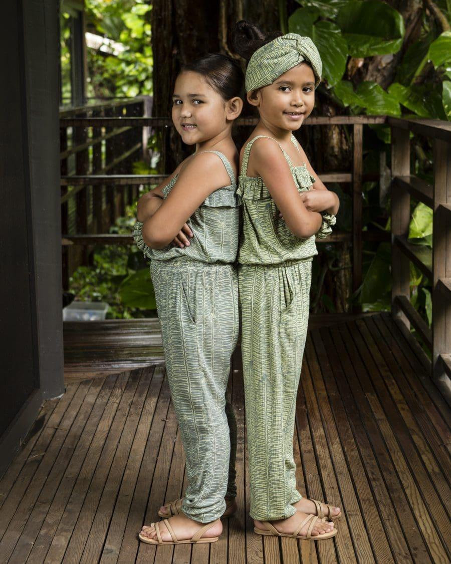 Two girls wearing Top Penny top and Alakai Jogger in Lily Pad Margarita Kupukupu pattern
