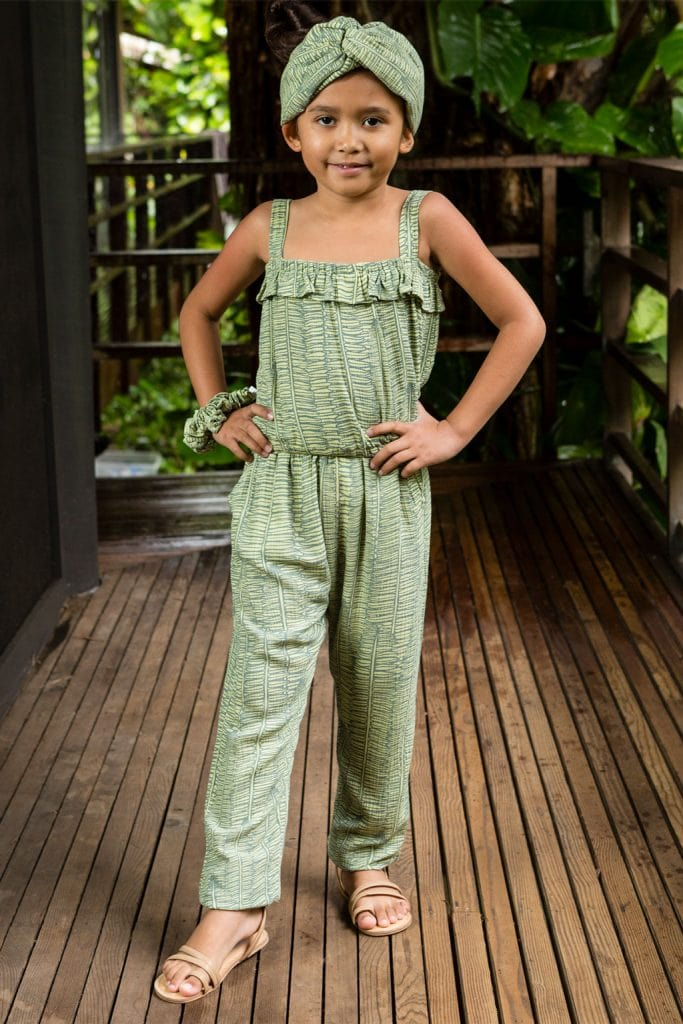 Child wearing Top Penny top in Margarita Lily Pad Kupukupu pattern