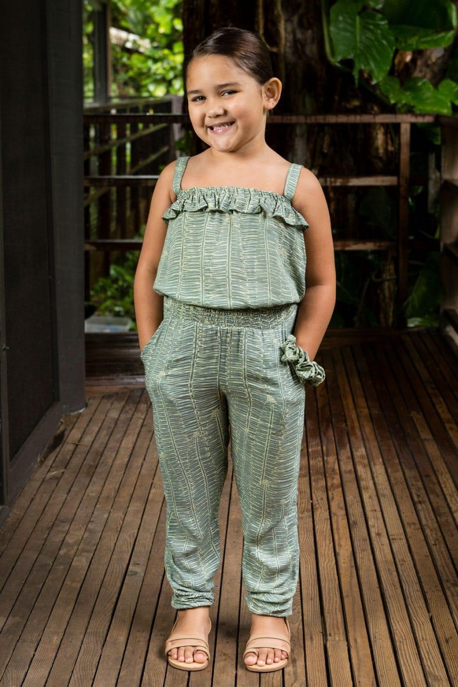 Child wearing top penny in Lily Pad Margarita Kupukupu pattern