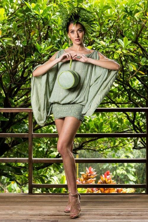 Model holding Lily Pad Margarita Kupukupu Pattern Lei Bag