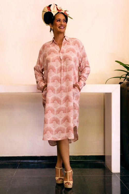 Female model wearing Ulupono Dress in Kalihilehua Pattern and Ash Rose-Lotus Color - Front View