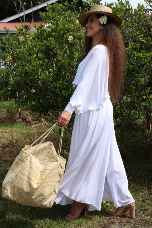 Female model holding Holoholo Tote in Ako'Ako'a Pattern and Rise Color - Side View