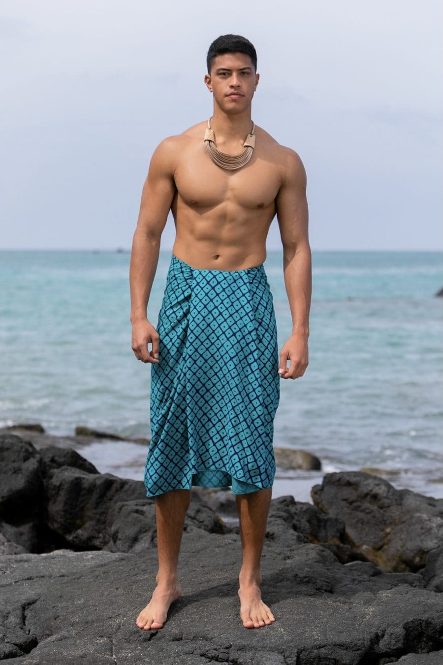 Male model wearing a Pareo in Upena Pattern and Tilandsia/Blue Grass Color - Front View