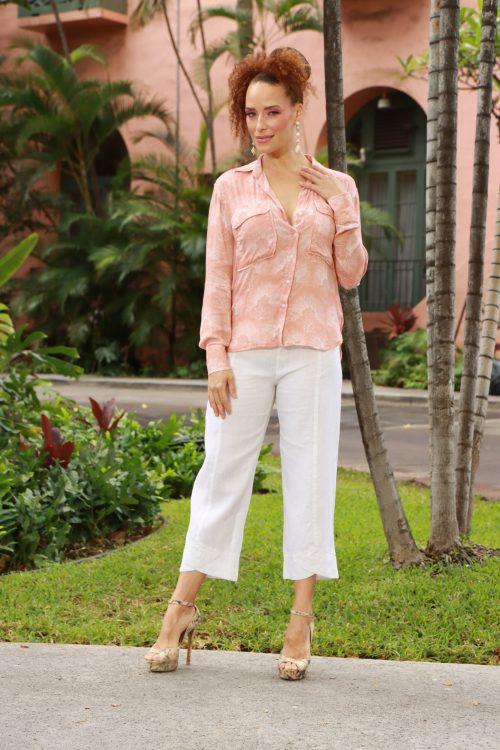 Female Model wearing Malino Shirt in a Kalihilehua Pattern and Lotus-Ash Rose Color - Front View