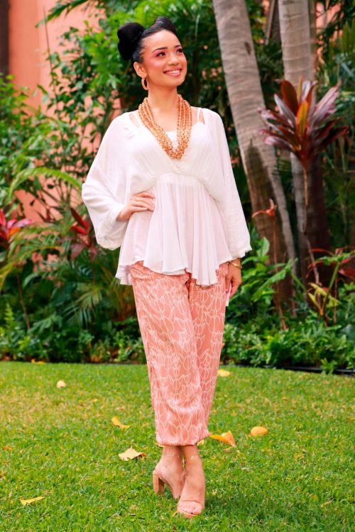 Female model wearing Nahele Pant in a Kapualiko Pattern and Lotus-Ash Rose Color - Front View