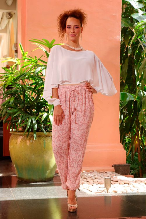 Female model wearing Uluhala Joggers in a Kapualiko Pattern in Ash Rose and Lotus - Front View