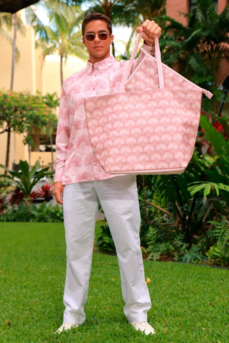 Male Model holding a Wailani Tote in a Kalihilehua Pattern and Lotus-Ash Rose Color