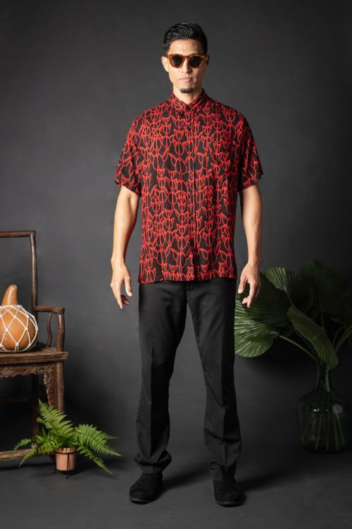 Male model wearing Aloha Shirt S-S in a Kapualiko Pattern and Black-Fiery Red - Front View