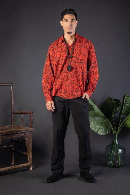 Male model wearing Hilo Shirt L-S in a Kapualiko Pattern and Fiery Red-Black - Front View