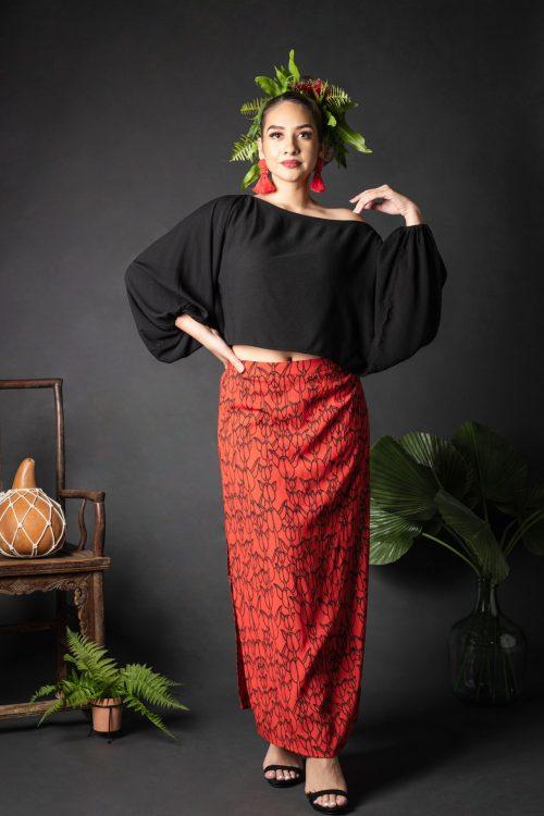 Female model wearing Kahiki Skirt Long in a Kapualiko Pattern in Fiery Red-Black - Front View