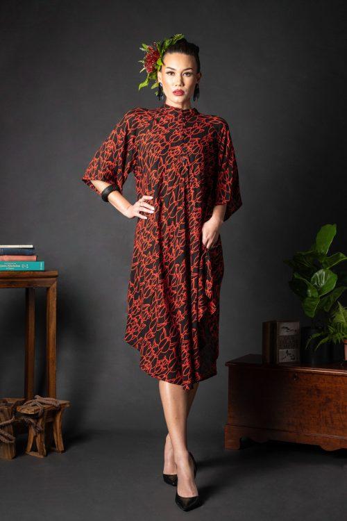 Female model wearing Koali Cut Dress in a Kapualiko Pattern in Black-Fiery Red - Front View