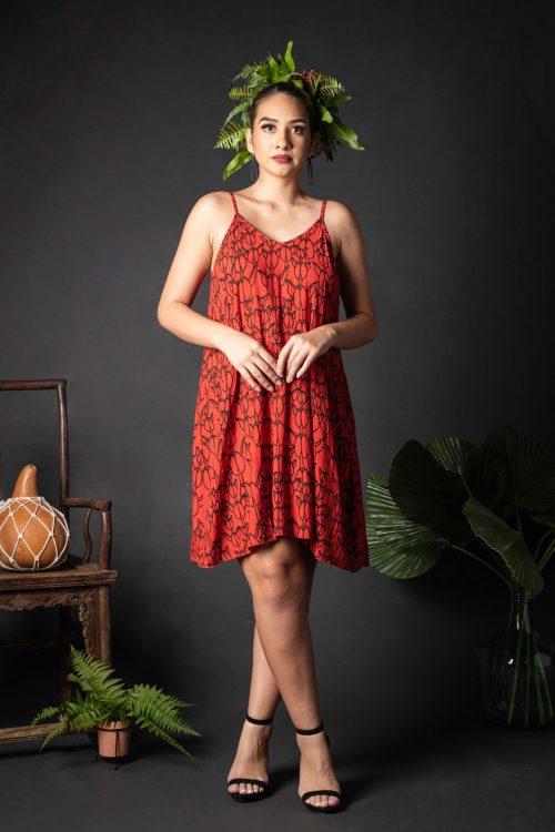 Female model wearing Kuakini Short Dress in a Kapualiko Pattern in Black-Fiery Red - Front View