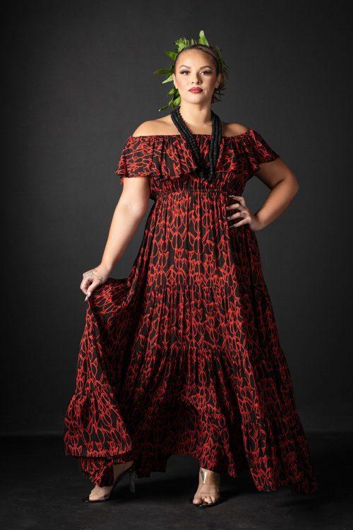 Female model wearing Lauae Maxi Dress in a Kapualiko Pattern in Black-Fiery Red - Front View
