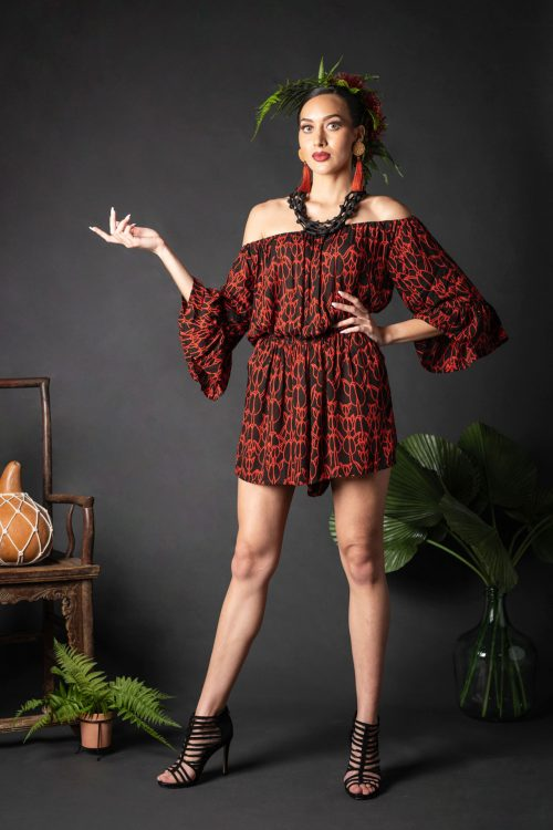 Female wearing a Manako Romper in Kapualiko Pattern and Black-Fiery Red - Front View