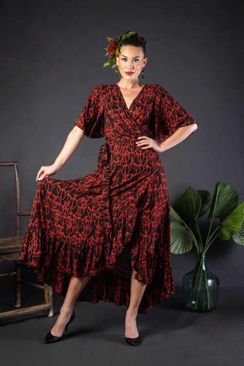 Female model wearing a Sepania Dress in Kapualiko Pattern and Black-Fiery Red - Front View