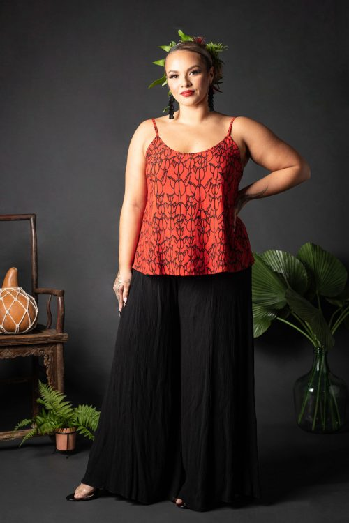 Female model wearing a Manaola Top 6 in a Kapualiko pattern and Fiery Red and Black Color - Front View