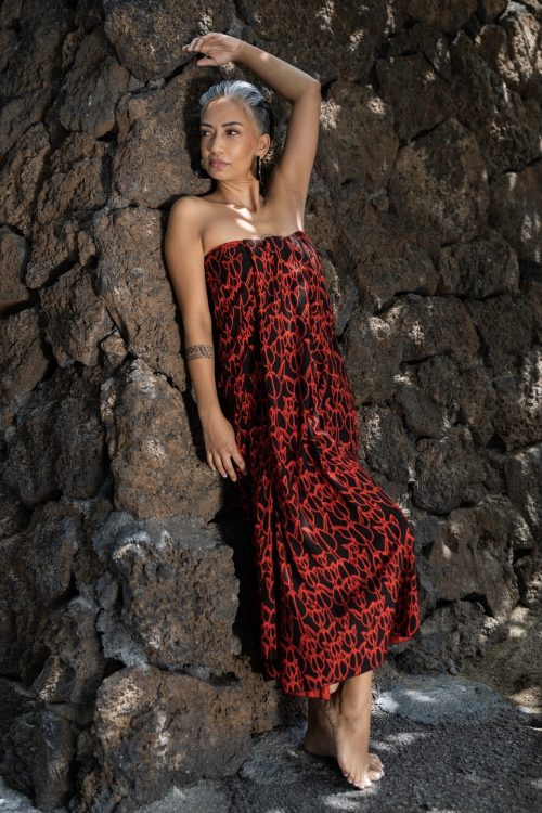 Female model wearing a Pareo in Kapualiko Pattern and Blk/Firey Red Color - Front View