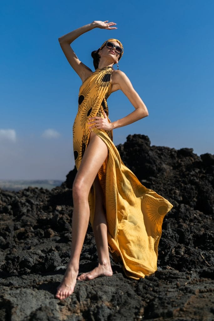 Female model wearing a pareo in Golden Kanehoalani - Front View
