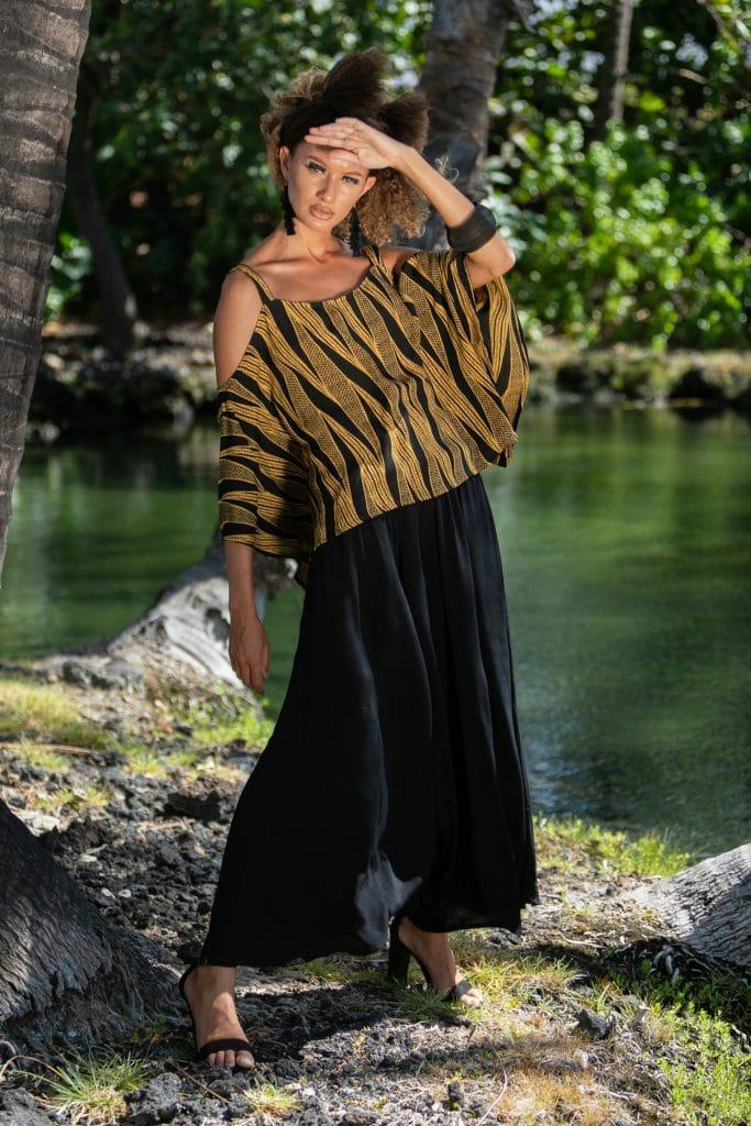 Female model wearing Konane Top in Kanehoalani Pattern - Front View