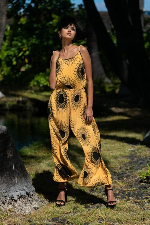 Female model wearing Leahi Jumpsuit in Kanehoalani Pattern - Front View